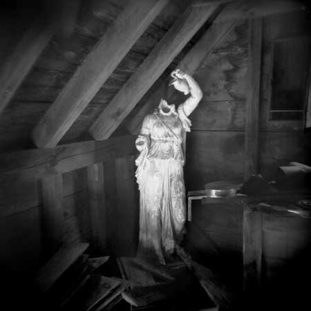 Found in an abandoned attic of a 19th-century New York home, a lost garden statue, minus its head. cinnamon