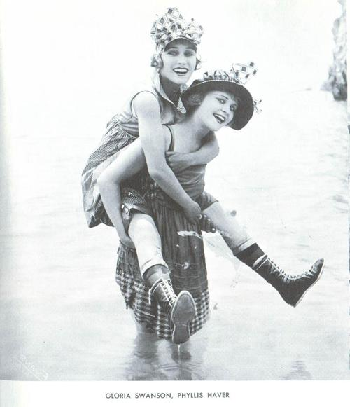 Actresses Gloria Swanson (1899-1983) and Phyllis Haver (1899-1960) happy go
